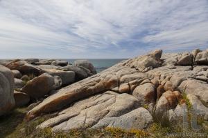 Sea and rough rocks at Bingie Point. Nsw. Australia.