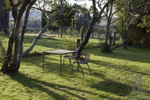 Table and chairs in a country house garden. Bingie. Nsw. Australia.