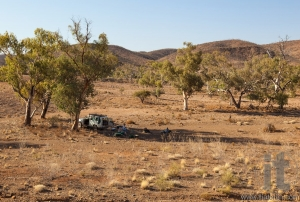 People are resting in shade of a tree on a very hot day. Flinders Ranges. South Australia.