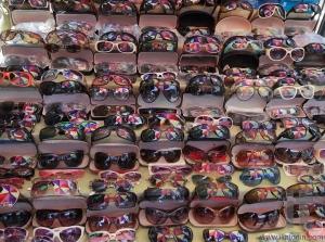 Colourful umbrella reflected in sunglasses on street market. Yangon. Myanmar.