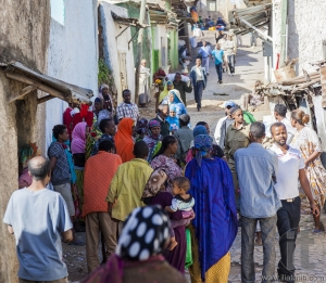 HARAR, ETHIOPIA - DECEMBER 23, 2013: Unidentified people of ancient walled city of Jugol in their daily routine activities that almost unchanged in more than four hundred years.