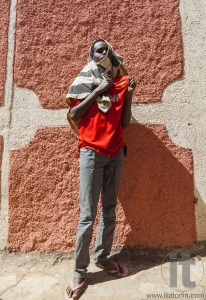 HARAR, ETHIOPIA - DECEMBER 24, 2013: Unidentified young man posi