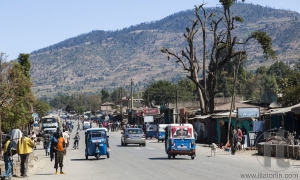 HIRNA, OROMIA REGION, ETHIOPIA - DECEMBER 22, 2013: There is no busy traffic on the main street of a small provincial town. Tuk-tuks are the major mean of transport.