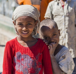 HIRNA, OROMIA REGION, ETHIOPIA - DECEMBER 22, 2013: Unidentified Ethiopian children in small provincial town. Despite government efforts to fight poverty it is still widespread in Ethiopia.