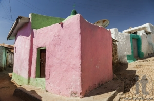 Pink house in narrow alleyway of ancient city of Jugol in the mo