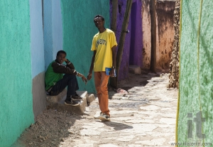 Two young men posing in typical surroundings in ancient walled city of Jugol, that daily life is almost unchanged in more than four hundred years. Harar. Ethiopia.