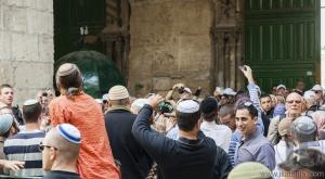 People celebrate near exit from Temple Mount. Jerusalem, Israel.