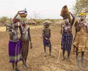 Children and Woman from Mursi tribe in Mirobey village. Omo Vall