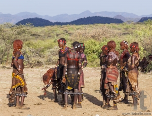 Group of Hamar women dance during bull jumping ceremony.