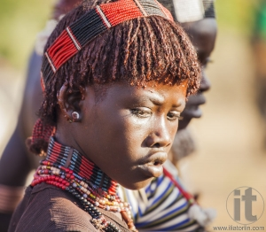 Portrait of young Hamar woman at bull jumping ceremony.