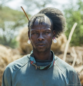 Traditionally dressed man from Tsemay tribe. Weita. Omo Valley. Ethiopia.