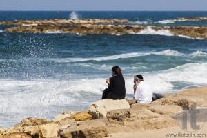 Couple at the seashore enjoys the view. Tel Aviv, Israel